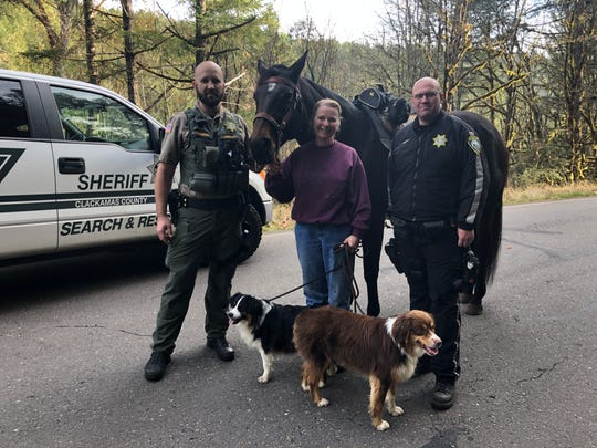 Tammy Stevens (middle) and Wilson the miniature Australian Shepherd (right) found a 2-year-old missing girl south of Molalla, Oregon.