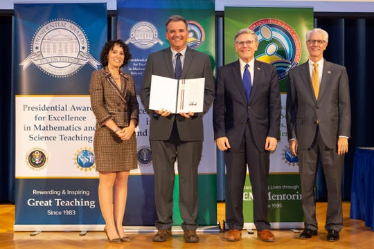 West Salem High School teacher Greg Smith was honored last month with the Presidential Award for Excellence in Mathematics and Science Teaching. Pictured left to right are Dr. Karen Marrongelle of the National Science Foundation, Smith,  Kelvin Droegemeier of the Office of Science and Technology for the White House and Fleming Crim of the National Science Foundation.