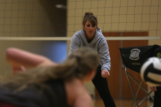 Head coach Melissa Holman runs drills during volleyball practice on Nov. 7 at Salem Academy, just days before the team competes at state championships.