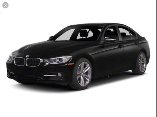 This is a photo of a black BMW 3 Series sedan, which is the type of vehicle three homicide suspects used to flee a mugging in which the victim, Ventura Urias, 47, later died. Police are asking for the public's help.