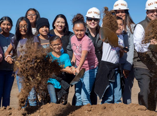 Kids from the community join in on the fun and dig into the ground during the groundbreaking ceremony in Soledad, Calif, on Friday, Nov. 08, 2019.