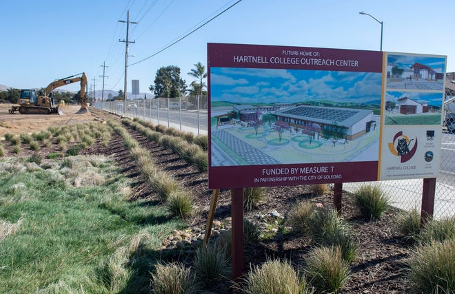 Members of the Hartnell board dig into the ground during the groundbreaking ceremony in Soledad, Calif, on Friday, Nov. 08, 2019.