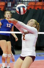 Luxemburg-Casco's Bekah Day (2) returns a serve from Wisconsin Lutheran at the WIAA state volleyball tournament Friday at the Resch Center in Ashwaubenon.