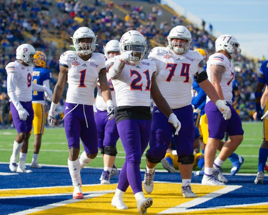 Jared West (21) celebrates after scoring a touchdown Saturday at McNeese.