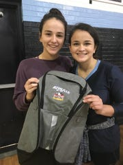 Airline's Riley Walden (left) recently won a Times/Sports Commission backpack as the area's Athlete of the Week. Her sister, Reagan, shares the moment with her.