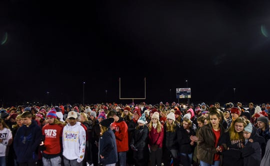 Community members gather to honor Lincoln High School freshmen Barry Grieve who died in a fatal car accident and Mhiretab Tsegaye who sustained life-threatening injuries in the accident during a candlelight vigil on Thursday, Nov. 7, 2019,  near the Sanford Pentagon. Over 300 hundred people attended the event and found support through shared stories and prayer.
