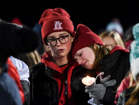 More than 300 students, parents, teachers and coaches attended a candlelight vigil on Thursday, Nov. 7, 2019, near the Sanford Pentagon.