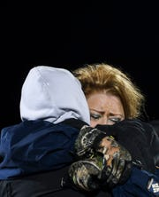 Sandra Grieve mourns her son Barry Grieve who died in a fatal car accident on I-229 during a candlelight vigil on Thursday night.