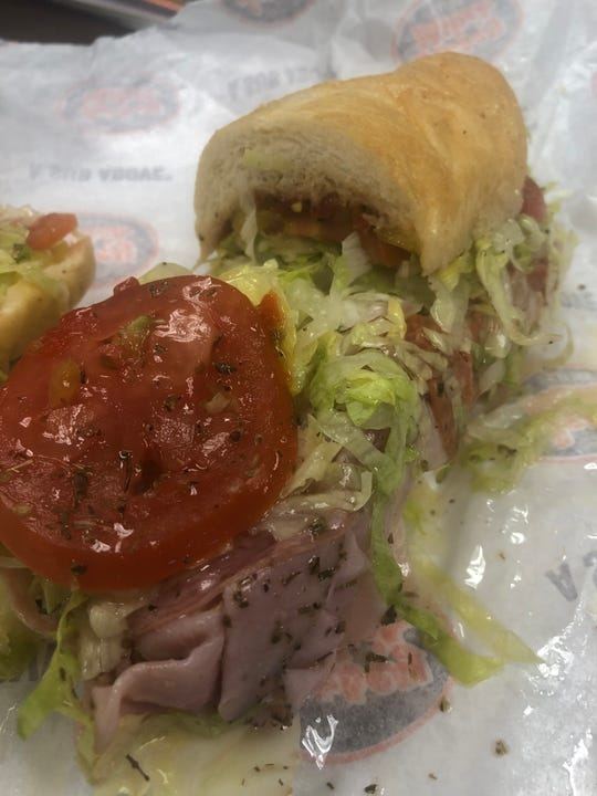 A sub sandwich slathered in olive oil at Jersey Mike's.