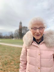 Phyllis Bunkers, 97, poses in front of the Coughlin Campanile Nov. 3, 2019 on the South Dakota State University Campus.