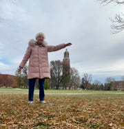 Phyllis Bunkers, 97, recreates a pose in front of the Coughlin Campanile Nov. 3, 2019 on the South Dakota State University Campus — about 80 years after the original photo was taken.