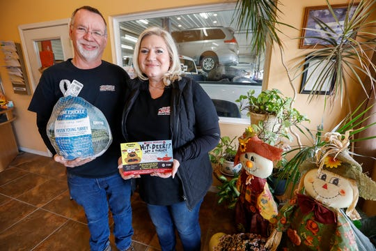 Randy and Tanya Boulware, owners of Advanced Auto Body & Frame in Bolivar, give away a free turkey to customers who hit a deer with their car.