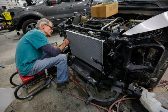 Collision technician Kevin Parsons repairs a vehicle that hit a deer at Advanced Auto Body & Frame in Bolivar, Mo., on Thursday, Nov. 7, 2019. The owners of the business give away a free turkey to customers who hit a deer with their car.