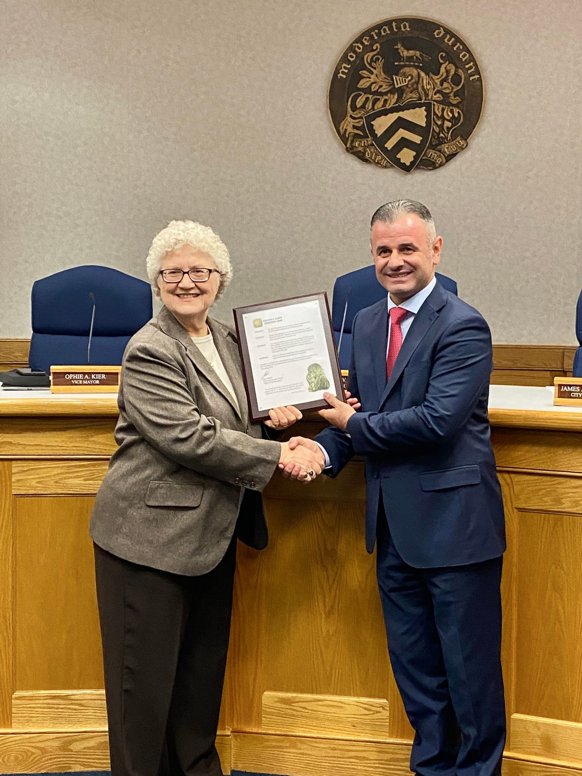 Staunton Mayor Carolyn Dull (left) stands with Çair Mayor Visar Ganiu on Thursday to receive a proclamation from the Skopje, North Macedonia, municipality establishing a sister city partnership.