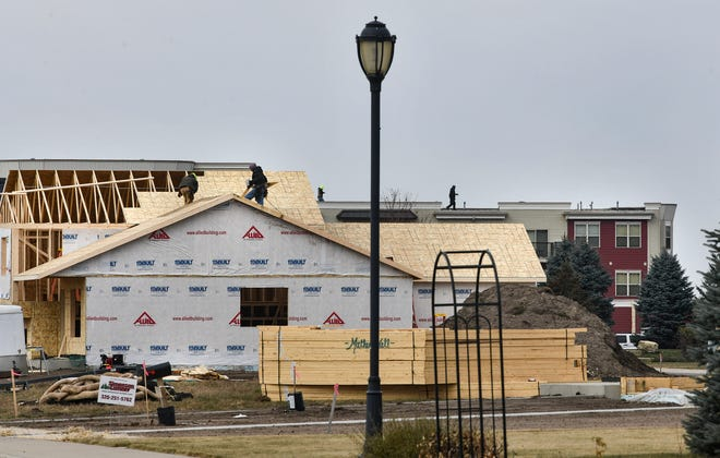 Home construction continues near existing apartment buildings Friday, Nov. 8, 2019, in Sartell.