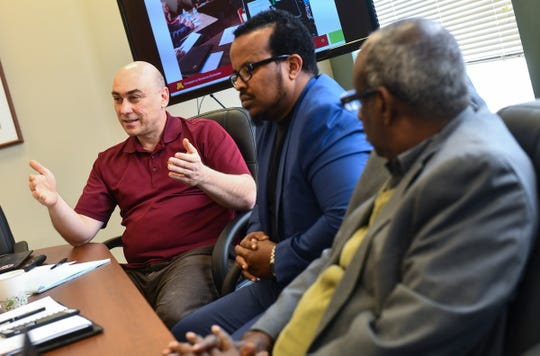 University of Minnesota Extension Educator for Health and Nutrition Programs Serdar Mamedov and community members Ahmed Abdi and Abdiaziz Odiriye  talk about a project to develop a supply of fresh goat meat to the area during an interview Friday, Nov. 8, 2019, in St. Cloud.