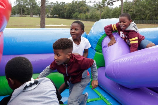 Oak Ridge Elementary School students play in a bounce house as the school celebrates its 50th anniversary Friday, Nov. 8, 2019.