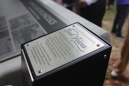 One of several historical markers in Frenchtown accompanied by oral history audio, photographed at the unveiling Friday, Nov. 8.