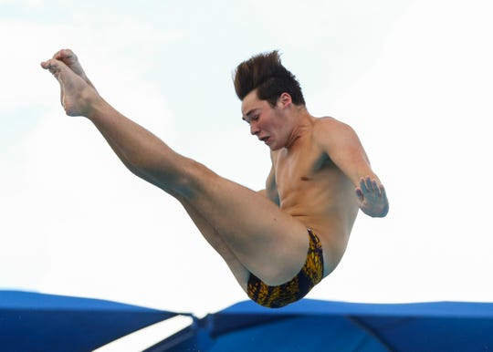 Lincoln Park Academy's Jonathan Geraghty does a backward 1 somersault tuck in the FHSAA Class 2A state diving final at Sailfish Splash Waterpark on Friday, Nov. 08, 2019, in Stuart.