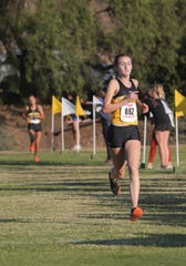 Newbury Park High's Fiona Hawkins heads for the finish line during the Marmonte League Cross Country Championships on Thursday at Peppertree Playfield in Newbury Park. Hawkins won the girls individual title in 17:15.15.