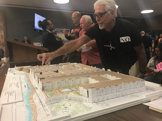 An opponent of the Fisherman's Wharf project checks out a scaled model of the 400 units proposed for Channel Islands Harbor. The model was made by a group of opponents using the project's development plans.