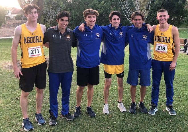 The Agoura High boys cross country team won the title at the Coastal Canyon League Cross Championships on Thursday.
