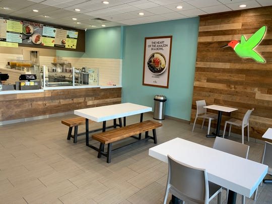 Robeks Fresh Juices and Smoothies in Thousand Oaks features the chain's hummingbird logo as part of the decor.