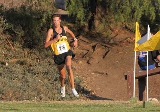 Newbury Park's Nico Young makse the final turn as he heads for the finish line during the Marmonte League Cross Country Championships on Thursday at Peppertree Playfield in Newbury Park. Young won the title in 14:04.17.