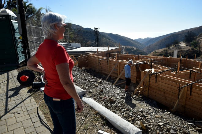 Larry Koch and wife, Pam Davison, visit their property on Yellow Hill Road, where their home was destroyed by the Woolsey Fire a year earlier, in November 2018.