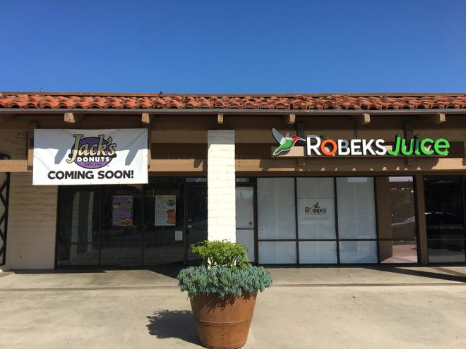 Robeks Fresh Juices and Smoothies in Thousand Oaks, right, will mark its grand opening with free samples and family-friendly activities on Nov. 9. Also seen in this May 2019 photo is Jack's Donuts, expected to open later this month.