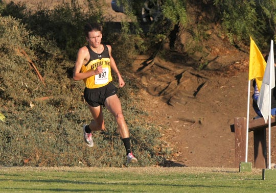 Newbury Park High's Jace Aschbrenner makes the final turn as he heads toward the finish line during the Marmonte League Cross Country Championships on Thursday at Peppertree Playfield in Newbury Park. Aschbrenner place second to teammate Nico Young as the Panthers won the boys team title.