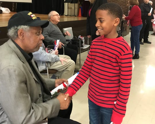 Vietnam veteran Lewis Green is thanked by fourth-grader Michael Mattocks after an assembly about Veterans Day at Strawtown Elementary in West Nyack on Friday, Nov. 8, 2019.