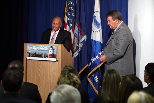 Westchester County Board of Legislators chairman Ben Boykin speaks as County Executive George Latimer looks on after unveiling a $2.1 billion budget plan for 2020, Nov. 8, 2019 in White Plains.