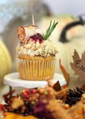 This Thanksgiving cupcake -- with a slice of turkey on top --  is one of many specialty cupcakes created by Caked UP Cafe in New City, Nov. 8, 2019.