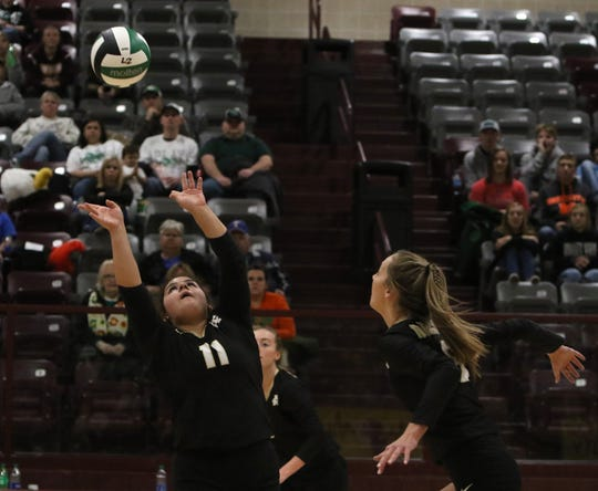 Archer City's Maddie Lopez sets the ball for Mallory Maxwell in the Region II-2A area playoff against Valley View Thursday, Nov. 7, 2019, in Bowie. The Lady Cats defeated the Eagles 3-1 (25-14, 25-22, 25-27, 25-23).