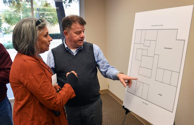 Deborah Bacashihua listens as Wichita Falls Chamber of Commerce president Henry Florsheim describes the layout of the new office spaces the Chamber will occupy on the first floor of the Hamilton Building downtown.