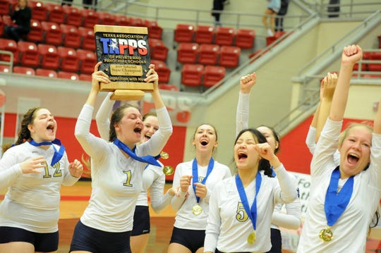 The Notre Dame Lady Knights celebrate winning the TAPPS Class A state championship Friday, Nov. 8, in West. Notre Dame defeated San Antonio Legacy Christian in straight sets.