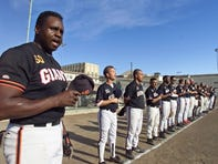 Jesse Reed, left, of San Quentin prison's baseball team the San Quentin Giants, sings the national anthem before a 2002 game.