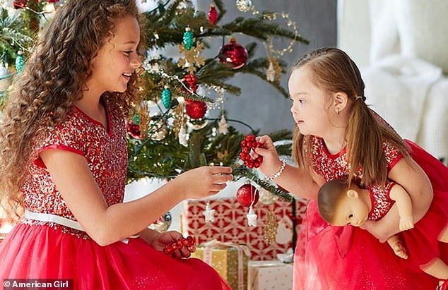 Ivy Kimble, right, is featured in the October holiday catalog for American Girl.