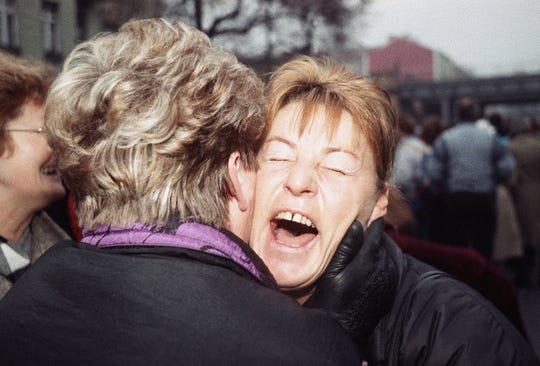 East German Rosemarie Doln is overwhelmed with emotion as she is welcomed by an unidentified relative at the opening of the wall passage at Wollankstrasse in West Berlin's district of Wedding on Nov. 13, 1989 in Berlin.