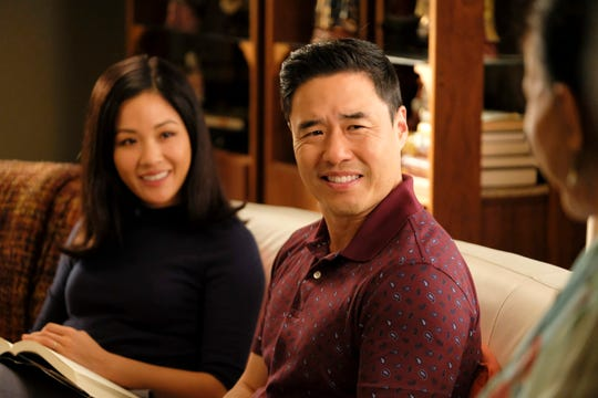 Constance Wu, left, and Randall Park star in ABC's 'Fresh Off the Boat,' which ends its six-season run on Friday.