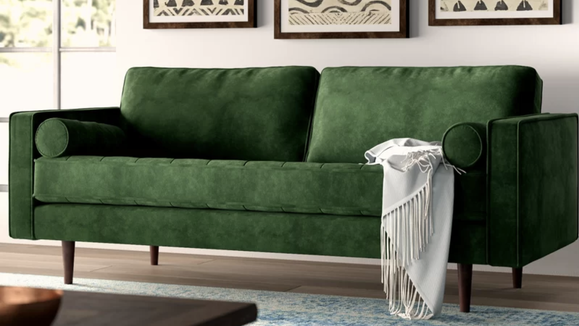 You'll want to sink into this velvet sofa for hours.