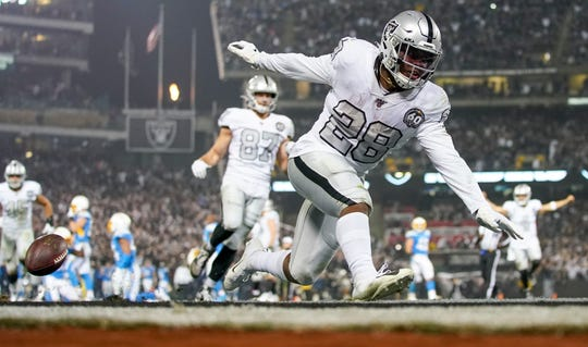 Oakland Raiders running back Josh Jacobs (28) scores the game-winning touchdown against the Los Angeles Chargers.