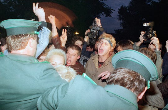 East German policemen, foreground, try to stop demonstrators from moving toward the East German parliament building, Oct. 7, 1989, where Soviet President Mikhail S. Gorbachev attended a reception. Several thousand young people demanded democratic reforms in East Germany.