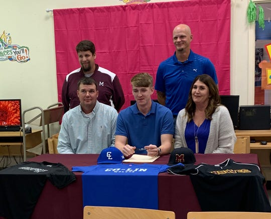 Monterey's Jacob Spinks (center, bottom) signed with Copiah-Lincoln Community College Friday. Bottom, from left are: father Chad Spinks, Jacob and mother Tori Spinks. Top, from left are: Monterey coach Patrick Wells and Jacob's longtime coach Brad Turney.