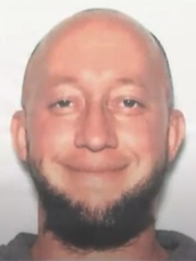 A booking photo for Casey John Cameron, 36, is seen in a screengrab from a livestreamed news conference.