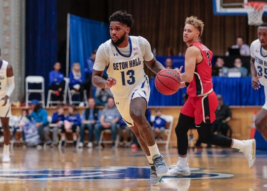 Seton Hall Pirates guard Myles Powell (13) drives to the basket against the Stony Brook Seawolves before leaving the game with an injury.