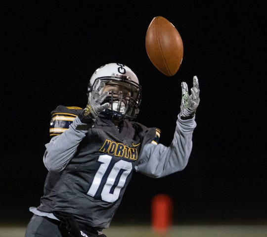 Toms River North wide receiver Zach Goodale catches a pass over the middle on his way to one of his two touchdowns in the Mariners' 42-17 win over South Brunswick in a NJSIAA Central Group V quarterfinal-round game.
