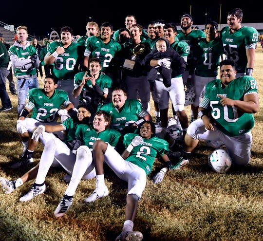 The Hamlin football team poses for a picture after beating Albany 66-20 to win the District 7-2A Division II title. The Pied Pipers moved up to No. 5 in the state rankings with the victory.