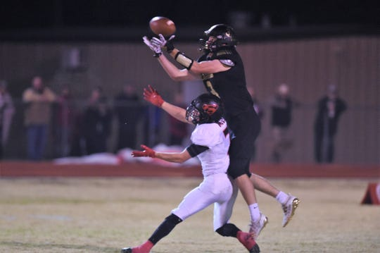 Gordon receiver Charles Mowles (3) catches a pass over a Strawn defender on Friday, Nov. 9, 2019. Mowles caught what proved to be the game-winning touchdown and conversion pass as the Longhorns won 27-26 to claim the District 10-1A Division II title.